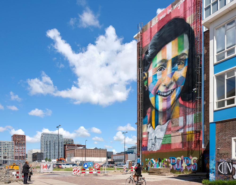 Anne Frank op de gevel van wat ooit een street art museum moet worden. Wandelroute Amsterdam-Noord, wandelen, duurzaam